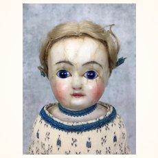 Antique wax over papier mache blue eyed beauty in silk dress