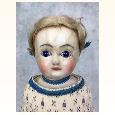 Antique wax over papier mache blue eyed beauty in silk dress