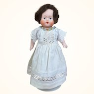Papier mache small doll with sweet dress