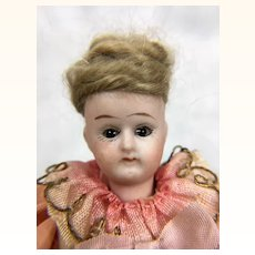 Antique dollhouse doll with swivel head and composition body