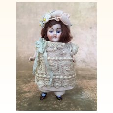 Miniature all bisque dollhouse girl with auburn hair
