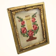 Miniature needlepoint in ormolu frame