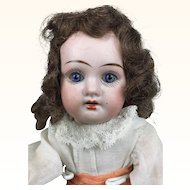 German bisque head doll in original clothing, mystery doll