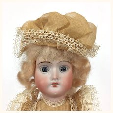 German Bisque head doll, Weifel & Co. , mint in original box