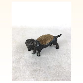 Older Vintage bronze colored metal and cloth Dachshund pincushion