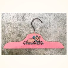 Vintage pink hanger for child sized or doll clothing