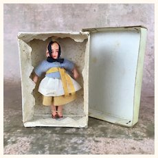 Miniature composition ethnic girl doll, MIB