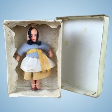 Miniature composition ethnic girl doll, MIB
