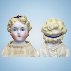 Antique turned head blonde china doll with Alice hairstyle