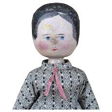 Vintage wooden carved folk art doll in Grodnertal style