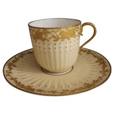 Limoges Cup & Saucer with Raised Gilt Design