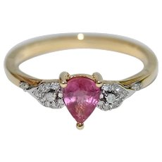 Rare Padparadscha Sapphire with Diamonds Ring