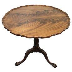 Baker mahogany tilt top table, round pie-crust top, birdcage support