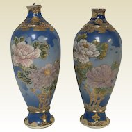 Pair of Antique Japanese Satsuma Vases With Flower Decoration Blue Background