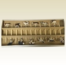 Set of 12 Japanese Carved Bone in Assortments of Dogs Tooth Picks