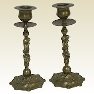 Pair of French Figural Brass Candlesticks With Puti Angel Figures
