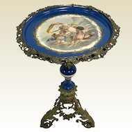 19th C Ornate Brass French Porcelain Top Pedestal Side Table W/ Putti Cherub Decoration