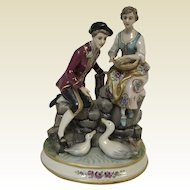 Large Italian Porcelain Figurine of Couple Feeding Geese Group