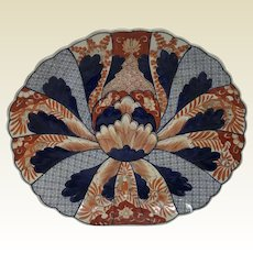 large Japanese Porcelain Imari Platter With High Relief Decorated Surface.