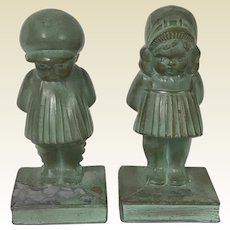 Cute Pair of Metal Boy & Girl Standing on Book Bookend