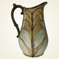 Antique Majolica Pitcher with White Floral Decoration & Scroll Handle