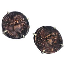 Silver stud earrings set with antique Roman coins.