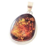 Big Baltic  Amber set in heavy  sterling  silver pendant in.