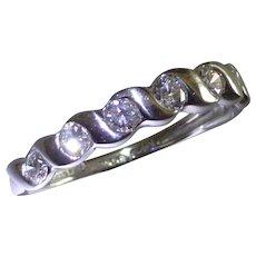 7 Brilliant cut Diamonds, 0.51 carats, All Platinum Half Eternity Ring.