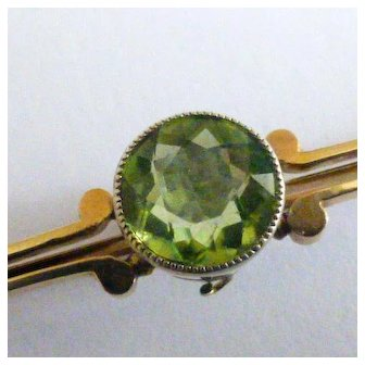 Fine round natural Peridot in 15k Brooch