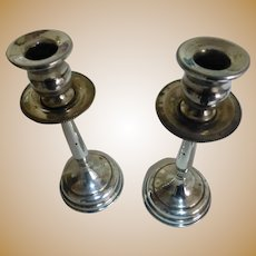 A pair of Solid Silver Candle Sticks