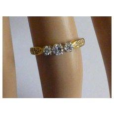 Neat 3 Stone 18k Diamond ring