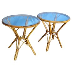 Two round Rattan matching end tables, mid century modern