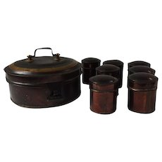 Early tole decorated round tin spice box with 7 spice containers