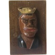 Folk art carved plaque with sailor man's bust