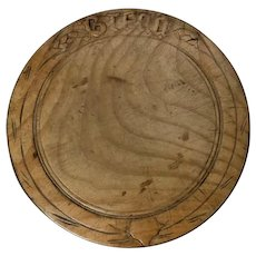 Round carved wooden Bread board