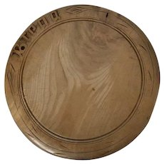 Carved wooden bread board