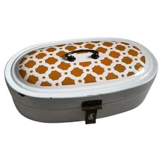 Oval enamel bread box with brass hardware and geometric decoration