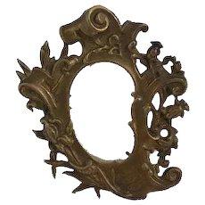 Ornate miniature bronze picture frame