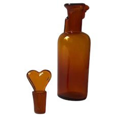 Medicine or perfume bottle with heart stopper