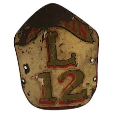 Early tin fire fighters helmet badge with excellent surface