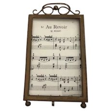 Gold ormolu easel back picture frame with beveled glass in the French style