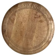 Traditional English round carved wooden bread board
