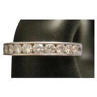 Brilliant Platinum Channel Set Diamond Ring - Featuring (10) Half Carat Diamonds - 5.8 Grams