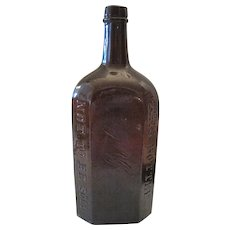 "Schutzen Str No9 J.A. Gilk A. Berlin 8-Sided Amber Bottle - 10"" Tall"