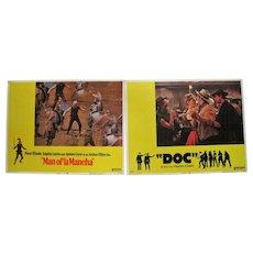 "Pair of Lobby Card Posters - ""Doc"" & ""Man of La Mancha"""