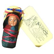 Vintage Skookum Indian papoose on cradleboard and original address card