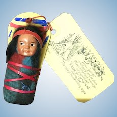 Vintage Skookum Indian papoose on cradleboard and original address card