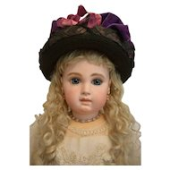"""Dramatic Vintage Black Hat with Purple and Pink Velvet Decoration"""