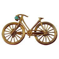 9ct gold Bicycle brooch with turquoise