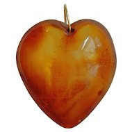 Antique carved amber heart with 9 ct gold bale